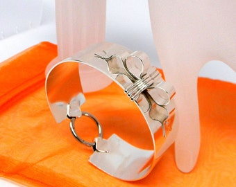 Wrapped Up with a Bow Solid Sterling Silver Cold Forged Cold Connection Slave Cuff with Stainless Steel Captive Segment Ring Clasp