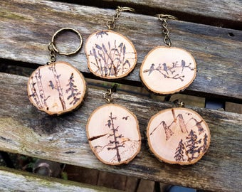 Woodburned Art Nature themed keychains, pyrography art, live edge wood slices, Mountains, Eagles, Birch trees, Birds or Rushes, nature lover