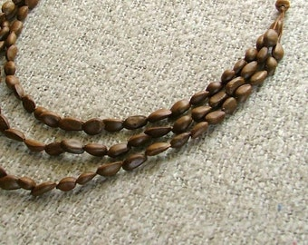 Natural seed necklace ,hand drilled seeds 3 strand necklace tribal vegan jewelry eco tribal necklace tagt team