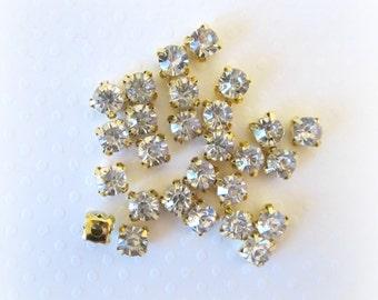 6mm Sew on Glass Rhinestones. Gold Colored Settings. QTY:  20 Pcs