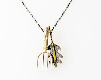 Garden fork and oak leaf pendant