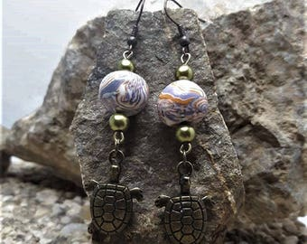 Earrings metal turtle and bead made of polymer clay.