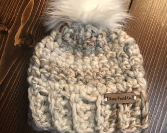 Newborn crocheted winter hat with faux fur pom