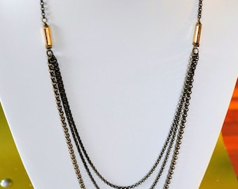 Multi strand tiered long antique brass necklace