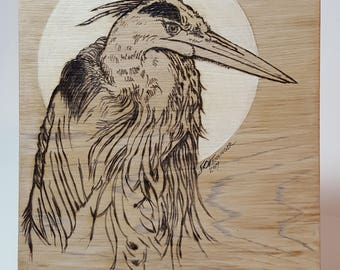 Great blue heron, wood burning with painted highlights