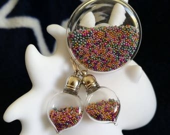 Earrings filled with blue microballs