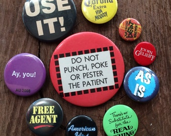 Set of ten assorted pin back buttons