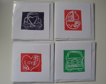 four lino printed cards