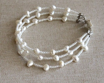 Multistrand beaded bracelet with natural freshwater white pearls and and czech crystals
