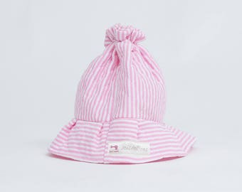 Hat of Pink Beach to cover the baby in summer.
