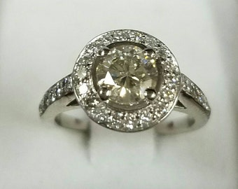 14kt white gold diamond halo engagement ring. One of a kind!!!