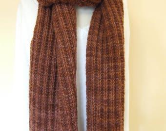Hand-knit merino wool ribbed scarf in autumn orange