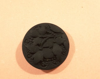 Czech glass button with matt black leaf design.