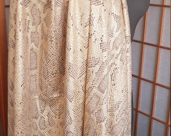Quality lycra gold base with brown and gold metallic snake pattern