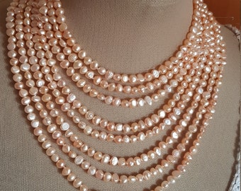 Pearl Necklace. 8 laps from major to minor. From the 64cm to the 42