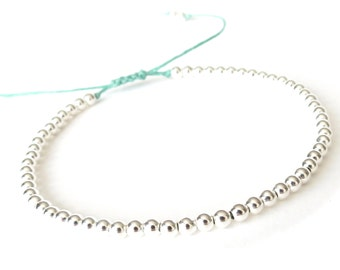 Tiny silver beads bracelet, turquoise Irish waxed linen cord bracelet with sliding knot, skinny friendship bracelet