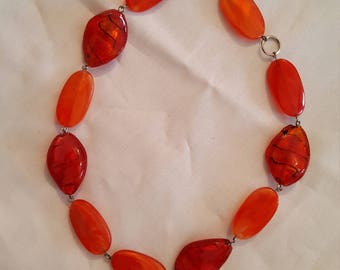 Necklace with red and orange stones