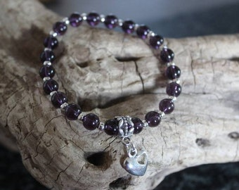 Lovely bracelet with semi precious Amethyst beads and heart charm.