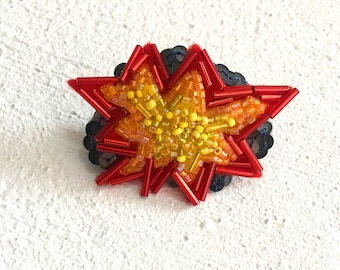 Explosion blast hand stitched beaded clip for brooch or hair. Made to order.