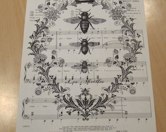 french crown with bees on vintage sheet music