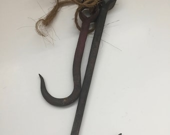 Two Antique Cast Iron Hooks Held Together by Bailing Twine