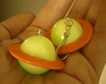 Get decked out like the fashionable Ms Frizzle with these glow in the dark Saturn earrings.