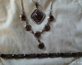 3 sterling pieces, 2 necklaces and 1 bracelet, garnet? red stones