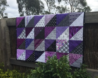 Purple, black, and white triangle baby girl quilt