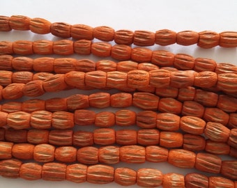 50pcs Orange Carved Wood Beads 7x10mm - UNFINW-060