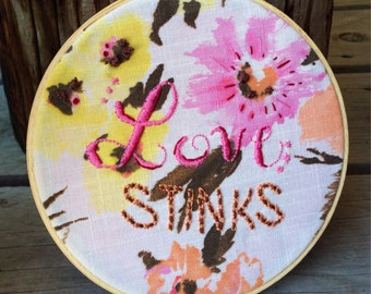 Love Stinks Humorous Quote, Hand Embroidered Hoop Art in Vintage Metal Hoop