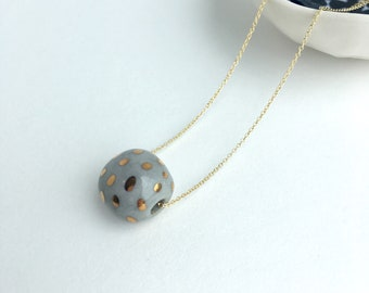 gold dots on marbled grey bead // porcelain necklace