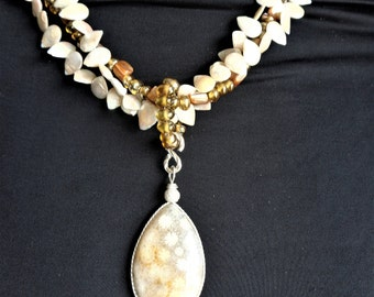 Fossil coral pendant on strand of freshwater pearl, shell & glass