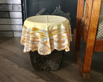 Large vintage hand crochet doily or small round tablecloth in light yellow fabric with gradient cream peach crochet lace, 14 in diameter
