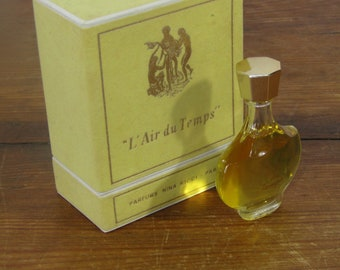 Small bottle of L'Air du Temps perfume in felted box