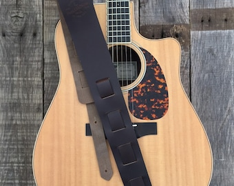 Adjustable, Horween leather guitar strap for acoustic or electric guitar.