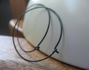 black hoop earrings. hammered niobium hoops. hypoallergenic jewelry. made in Calgary, Alberta.