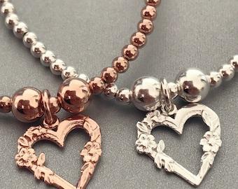 Sterling Silver/Rose Gold Floral Encrusted Open Heart Charm Bracelet