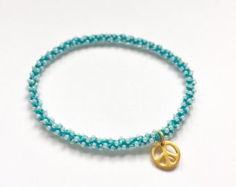 Stackable peace yoga charm bracelet Vissudha (throat chakra)