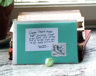 Courage doesn't always roar. Sometimes courage is the little voice ... Green card with handwritten quote and Swedish ermine postal stamp