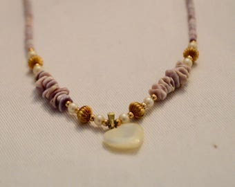 Lavender Pukka and Mother of Pearl heart shape necklace