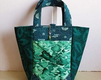 Reversible two pocket handbag