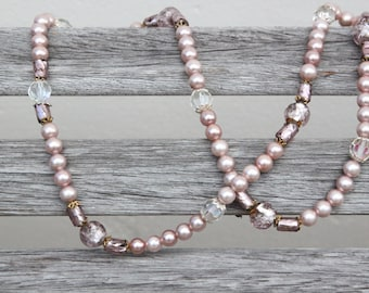 Pale pink beaded necklace with faceted glass beads