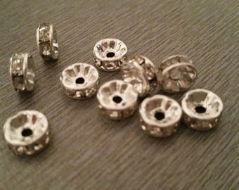 13 Silver earrings with 8mm silver rhinestone rondelles