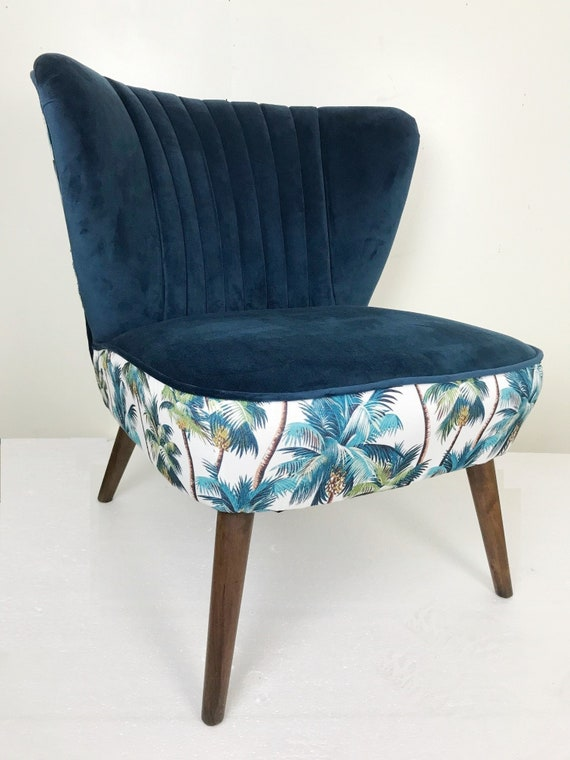 blue velvet winged upholstered occasional chair with tropical