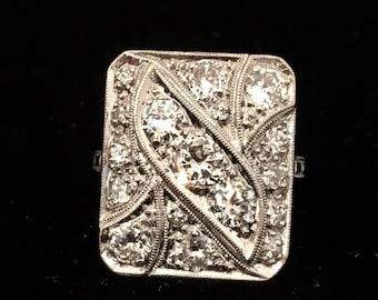 Art Deco platinum filigree diamond ring. Approximately 1.7ctw