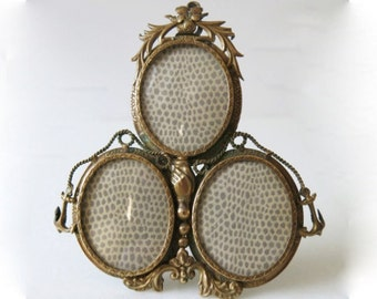 ANTIQUE BRASS FRAME - Rare French triple brass frame from the turn of the century