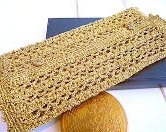 Golden hand-crocheted evening clutch