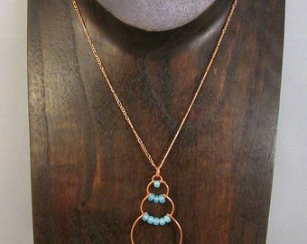 Copper wire bubble necklace with light blue beads