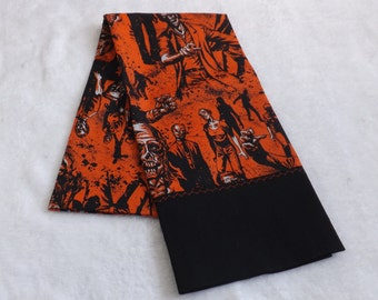 Pillowcase made from black and orange Zombie cotton fabric with black trim