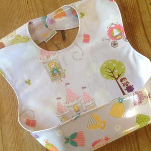 Laminated Snappy Pocket Bib, Fairy Tale Princess, Dream and a Wish in purple, laminated cotton, Crumb catcher, self feeder NOT oilcloth